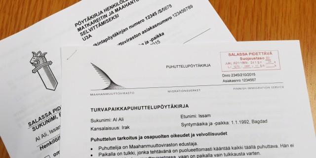 Turvapaikkapuhuttelupöytäkirja  Maahanmuuttovirastossa 14. syyskuuta 2015. LEHTIKUVA / MARKKU ULANDER